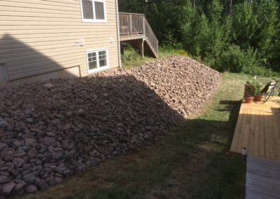 Shot rock Retaining wall project complete
